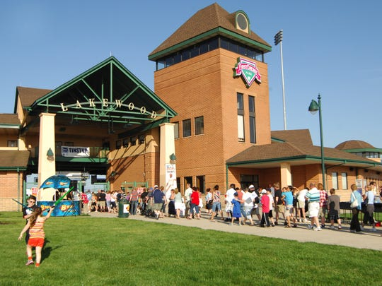 Fans line up at the gate at FirstEnergy Park for a Lakewood BlueClaws game.