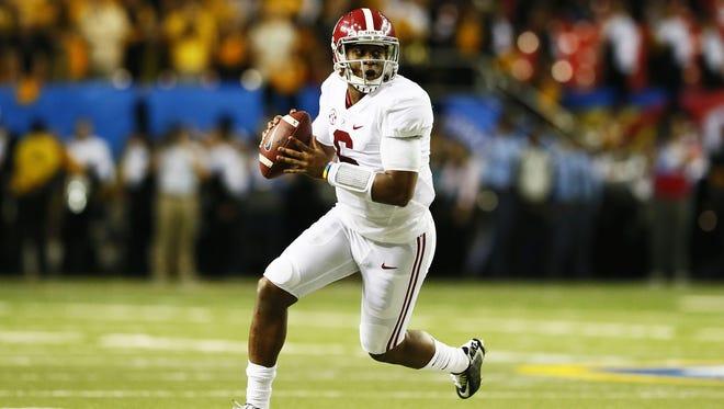 Alabama quarterback Blake Sims scrambles against Missouri during the SEC title game in Atlanta.
