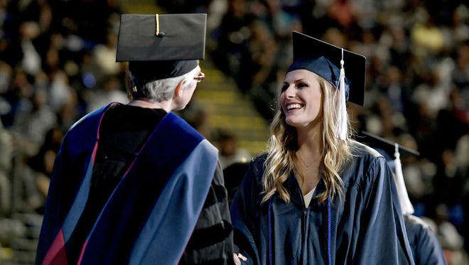 Paige Raque graduates from the Penn State College of Health and Human Development on May 7.