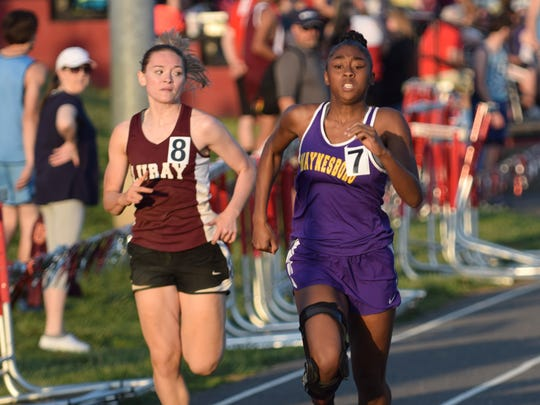 Waynesboro's Nejzaria Howard stays ahead of Luray's Lucy Buracker in the girls 100-meter dash during the Augusta County Invitational track and field meet at Riverheads High School on Friday, April 28, 2017. Howard placed second.