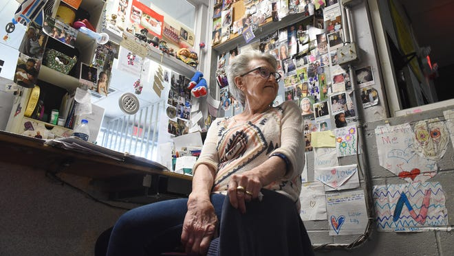 Naomi Griffith sits in the front office of the Roll-A-Way Skating Center on Church Street in Newark. The office is decorated with photos of generations for employees and customers. Naomi's father-in-law, Virgil Griffith built the business in 1954. Naomi and her husband, Elton, both work together at the business.