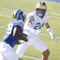 """""""We're young guys, we're hungry, our bodies feel good and we're running around,"""" said junior safety Ryan Torzsa (right)."""