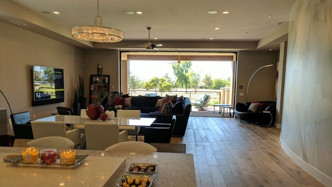 Visitors to the Malandro home have a view through to the Biltmore golf course from her kitchen thanks to fully retractable sliding that leads to the patio.