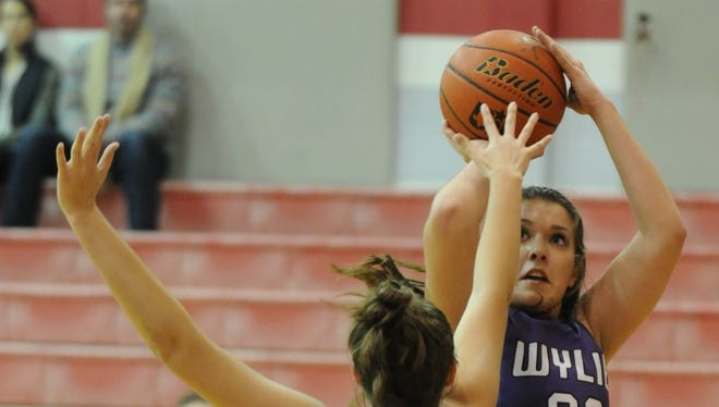 Wylie's Gabby Zullo, right, shoots over Jim Ned's Halle Cooley. Wylie beat the Lady Indians 47-40 in the nondistrict game Monday, Dec. 19, 2016 at Bill Thornton Arena in Tuscola.