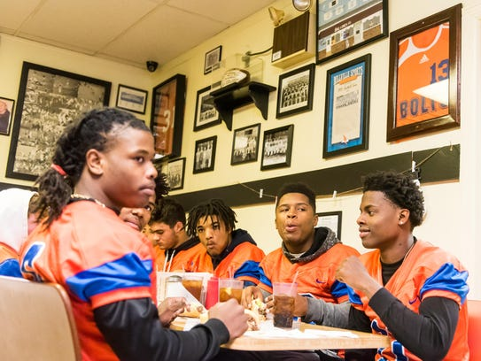 Millville football players enjoy a free meal at Jim's