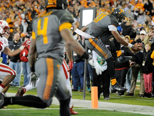 Tennessee Volunteers quarterback Joshua Dobbs (11) goes into score during the second half of the Franklin American Mortgage Music City Bowl at Nissan Stadium in Nashville, Tenn., Friday, Dec. 30, 2016.