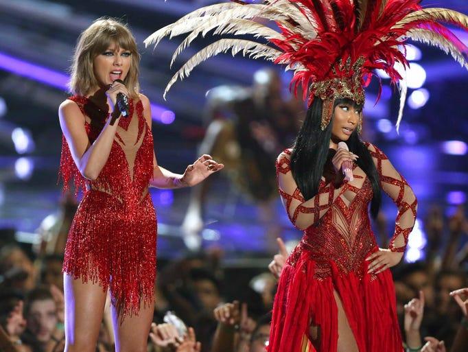 Taylor Swift, left, and Nicki Minaj perform at the