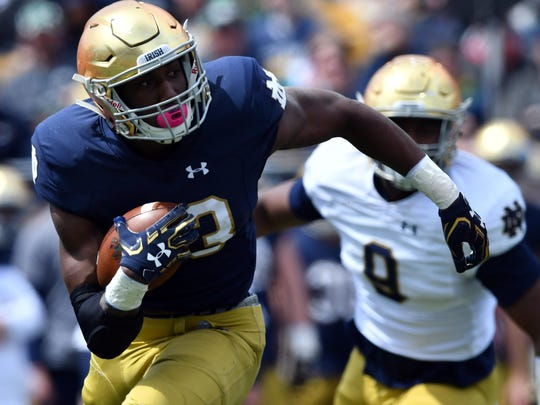 Fighting Irish running back Josh Adams (33) carries in the first quarter of the Blue-Gold Game at Notre Dame Stadium.