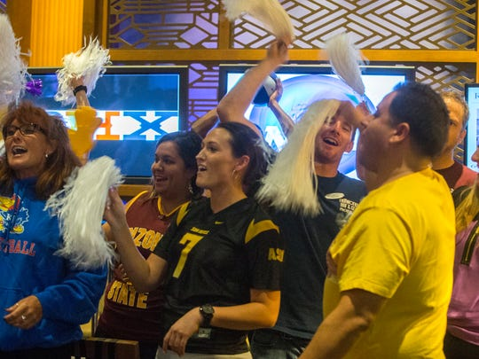 Basketball fans show their support for the NCAA Final Four host committee in the lobby of the Hyatt Regency Phoenix, as part of their tour of Phoenix, named one of eight finalists for the tournament in 2017, 2019 or 2020. The committee will announce its decision in November.