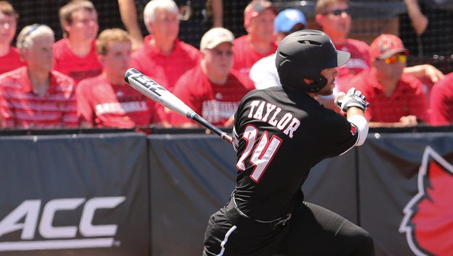 U of L's Logan Taylor (24) knocked in teammate Tyler Fitzgerald (2) against UK during the super regional at Patterson Stadium.June 10, 2017