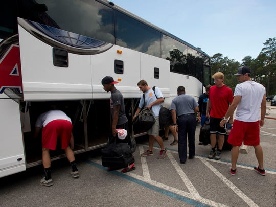 Northwest Florida State College baseball team prepares to load their luggage onto a bus bound for the NJCAA World Series in Colorado this weekend. The Raiders feature three players and a coach with ties to Pensacola.