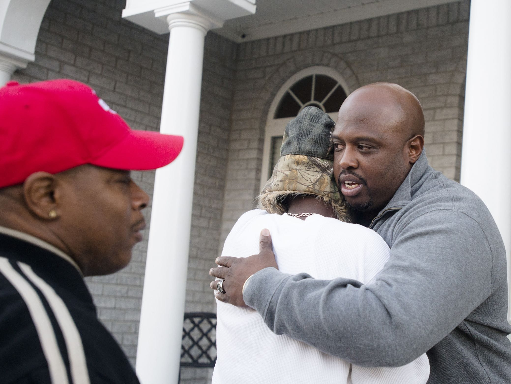 Mario Mitchell, father of Auburn football player Jakell Mitchell, consoles William Jones, a friend of Jakell's outside his home in Opelika on Sunday. Jakell Mitchell, 18, died after being shot early Sunday at an off-campus apartment complex. Mario Mitchell, father of Jakell Mitchell, consoles William Jones, a friend of Jakell's, outside his home in Opelika on Sunday.