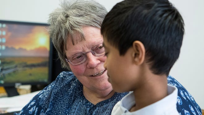 Jan McEntee speaks with her student Shahid Shaik at St Mary School in Sioux Falls, S.D. on Thursday, May 17, 2018.