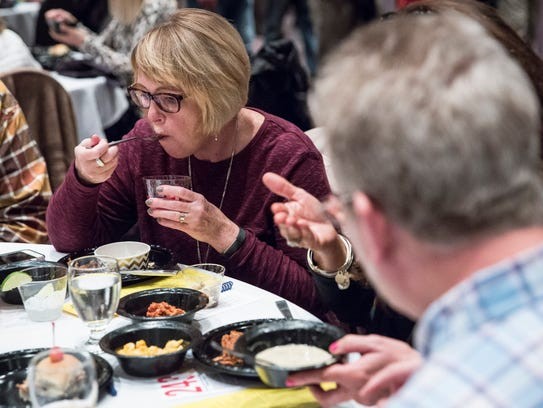 Hungry patrons chow down on dozens of different dishes