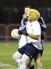 Stayton's Cristian Gomez and the Eagles defeat Henley 2-1 in the semifinals of the OSAA Class 4A state playoffs on Tuesday, Nov. 10, 2015, at Sprague High School.