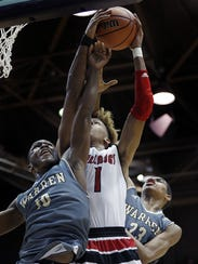 Romeo Langford (1) is double teamed by Warren Central's