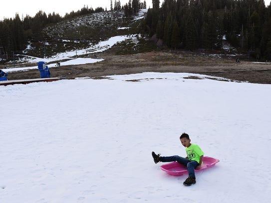 7-year-old Jiatong Cai, visiting from China, sleds