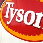 FILE - In this file photo made Oct. 28, 2009, a Tyson Foods Inc., truck is parked at a food warehouse in Little Rock, Ark. Tyson Foods Inc. returned to a profit in its fiscal fourth quarter Monday, Nov. 22, 2010, partly helped by higher prices and improved pork and prepared foods sales.  (AP Photo/Danny Johnston, file)
