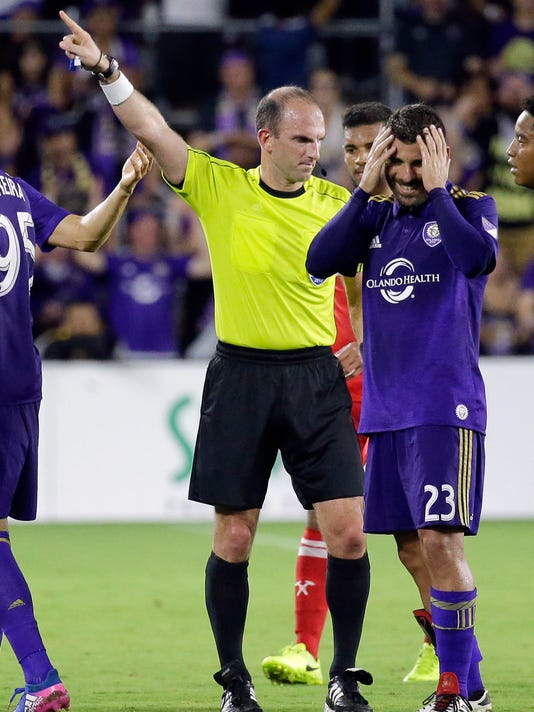 Orlando City's Antonio Nocerino (23) reacts after Referee Ted Unckel, left, gave him a red card ejecting him from the game during the second half of an MLS soccer game, Sunday, June 4, 2017, in Orlando, Fla. The game ended in a 0-0 draw. (AP Photo/John Raoux)