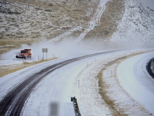 A Montana Department of Transportation truck plows an offramp on I-15 near Cascade.