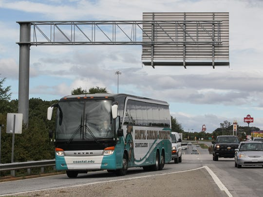 A Coastal Carolina University bus enters Interstate 85 heading to Greenville for a field trip Saturday. Some Coastal students and staff members are staying at Clemson University, away from their campus in Conway, because of Hurricane Matthew.