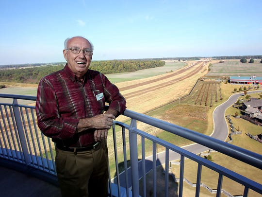 "Jim Rippy, CEO of Discovery Park of America, stands on the observation deck the 110-foot tower on the park's property that adjoins an easement and is nestled between two future exits on Friday, Oct. 28, 2016. ""The completion of I-69 locally will be a game changer for us, the quicker its completed the better,"" states Rippy."