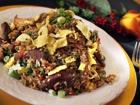 Arroz chaufa is a fried rice dish with beef, chicken and pork at Mama Irma in Fountain Square.