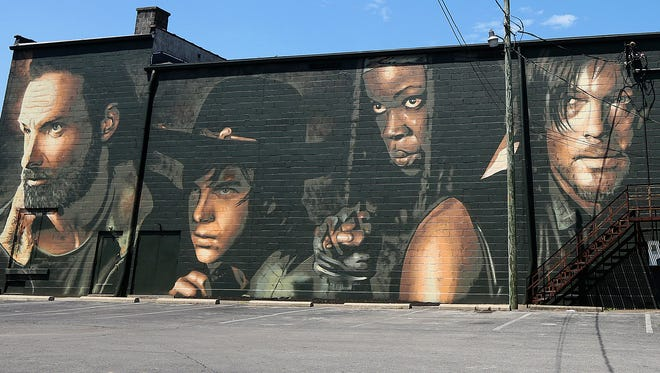 """Portuguese artist Sergio Odeith painted a mural in Cynthiana, Kentucky - hometown of the creator of and the original artist for """"The Walking Dead."""""""