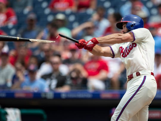 Philadelphia Phillies' Jake Arrieta breaks his bat while hitting a single in the third inning.