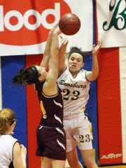 Enosburg's Emilee Bose, right, passes out of defensive