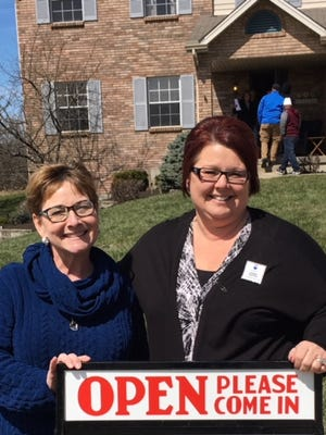 Donna Deaton, right, of ReMax Victory in West Chester, stands outside on open house she hosted before the coronavirus pandemic began.