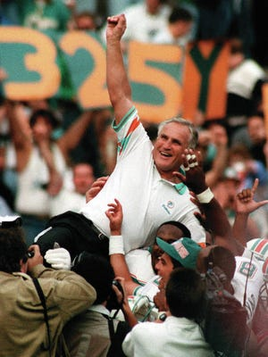 Miami Dolphins coach Don Shula is carried on his team's shoulders after his 325th victory, at Philadelphia's Veterans Stadium on Nov. 14, 1993. Shula coached for 33 years and won a record 347 games. That includes 17 victories in 1972, when Shula's Miami Dolphins achieved the league's lone perfect season. Seven members of that team went on to the Pro Football Hall of Fame _ Shula, linebacker Nick Buoniconti, fullback Larry Csonka, quarterback Bob Griese, center Jim Langer, guard Larry Little and receiver Paul Warfield.