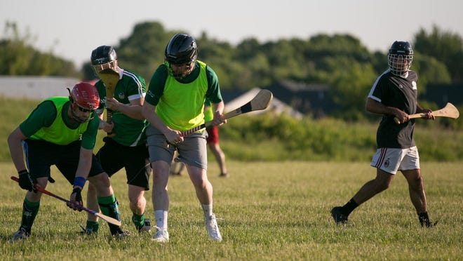 Players scrimmage during a practice of the Rochester Hurling Club in Henrietta.