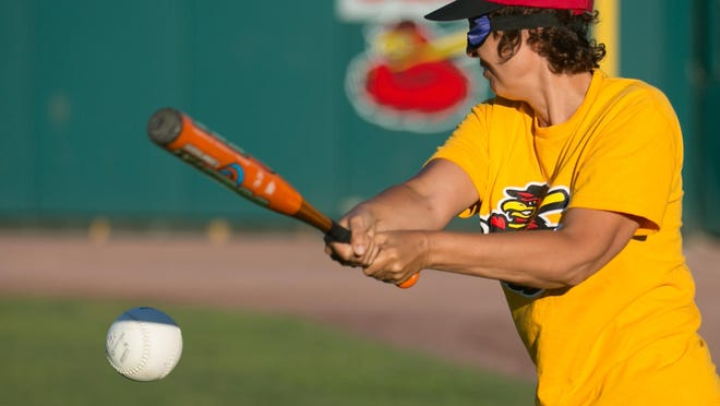 Lea Werner of West Irondequoit swings at a pitch during a demonstration of Beep Baseball at Frontier Field in Rochester on Tuesday, June 23, 2015.
