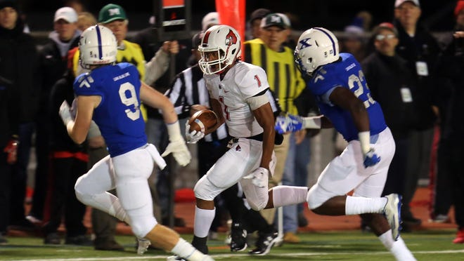 Colerain running back Syncere Jones runs for a first down in the Division 1 Football Regional Finals at Mason High School in Mason Ohio.