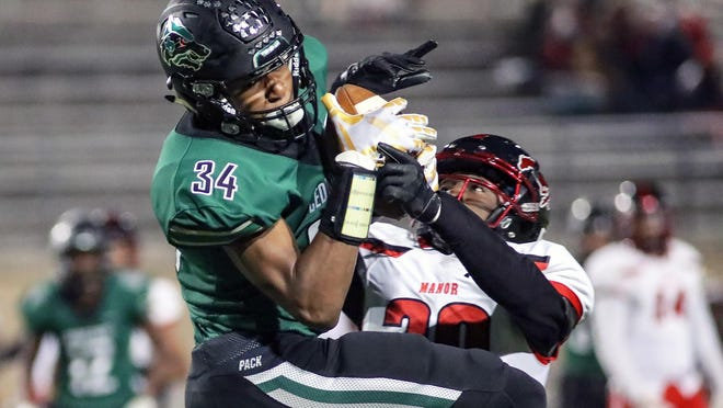 Cedar Park's Josh Cameron hauls in a second touchdown catch against Manor last season. Cameron returns as one of the top receivers in the Austin area.
