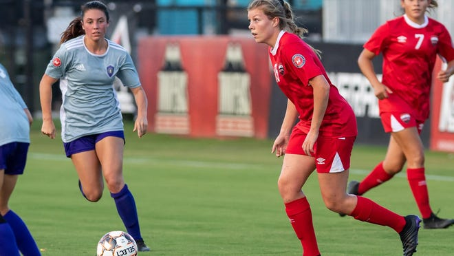 Austin Elite's Jayme Woodfill, center, looks for an opening during her team's 3-1 win over San Antonio Athenians in a Women's Premier Soccer League match last July. The game at Austin Bold stadium drew 1,205 fans.