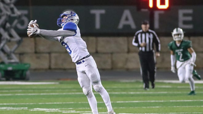 McCallum defensive back EZ Guenther makes a play on the ball in a 2019 playoff loss to Cedar Park. Guenther returns to the Knights as arguably the best defensive back in the district.