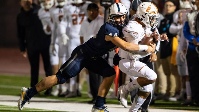 Jake Chambers of Stony Point tackles Westwood quarterback RJ Martinez in a game last season. Chambers, a junior now in his third year on varsity, had 145 tackles for the Tigers last season.