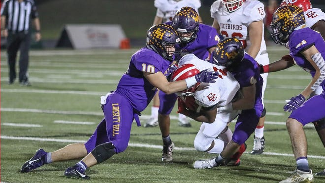 Liberty Hill linebacker Andon Thomas, left, and his Panthers teammates swarm an El Campo running back in the first quarter of a playoff game last season. Thomas returns as one of the top linebackers in the Austin area.