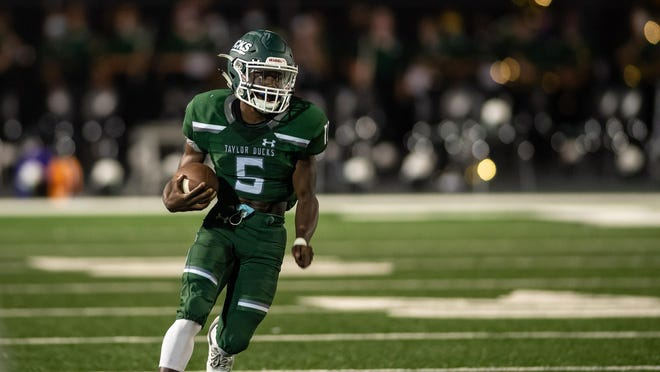 Ste'Kevion Johnson breaks a long kickoff return for a touchdown for Taylor during the Ducks' 26-21 season-opening loss to Robinson Friday at Taylor Stadium.