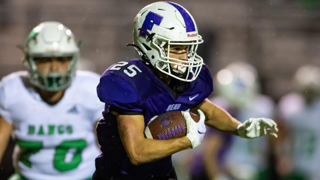 Florence running back Brenden Woljevach looks for a running lane during the Buffaloes' 55-0 loss to Bangs Friday in Florence. Woljevach led the Buffs with 15 carries for 53 yards.
