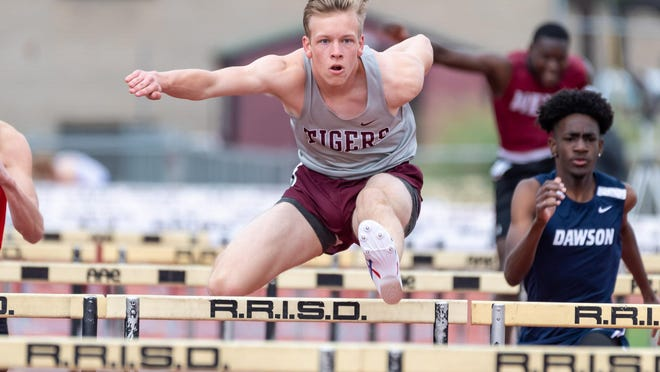 Coleman Chapman, hurdling for Dripping Springs at the Round Rock Invitational in early March, said he enjoys math and aspires to major in aerospace engineering in college.