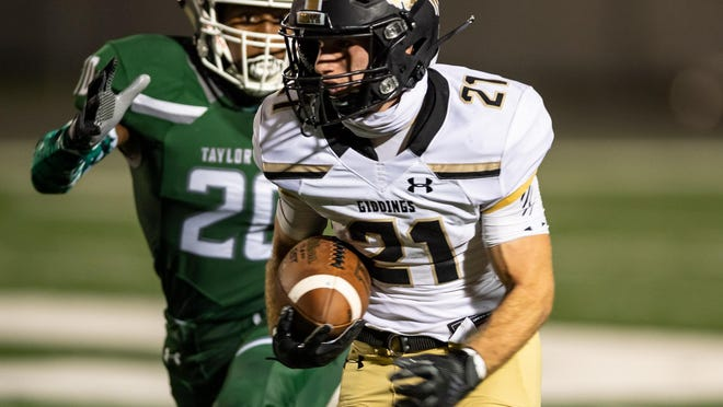Giddings' Gage Jaehne, running with the football against Taylor on Friday night, scored touchdowns while running, receiving and on special teams in the 46-12 victory.