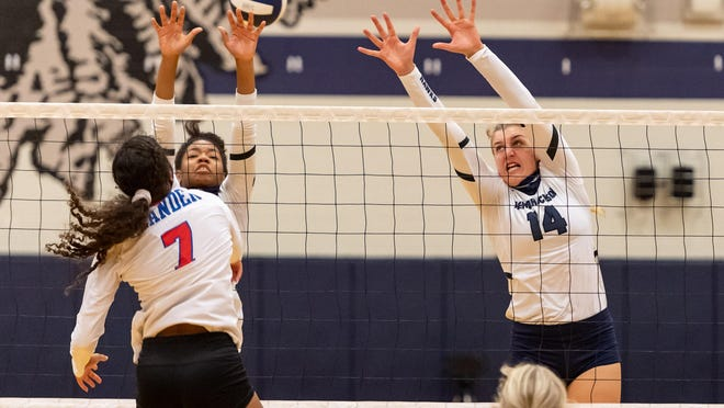 Karys Dove and Ella Wendel of Hendrickson go for a block against Mya LeVaughn of Leander. Hendrickson won at home against Leander in a doubleheader along with Round Rock on Sept. 18.
