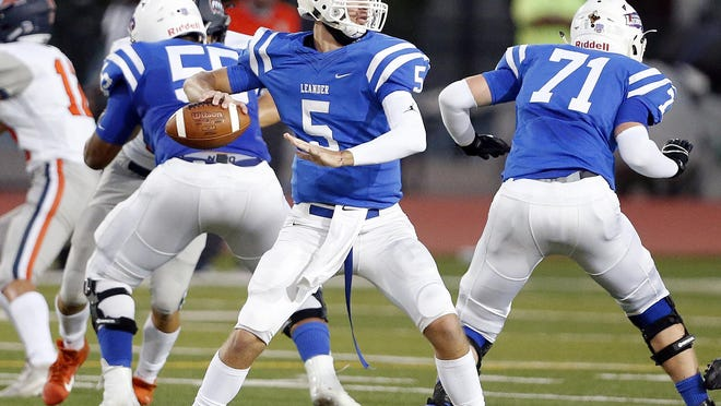 Leander quarterback Garrett Landry, throwing the football against Glenn earlier this season, threw for 201 yards and two touchdowns against Pflugerville as the Lions snapped a 22-game winning streak.