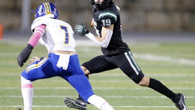 Cedar Park wide receiver Jack Hestera makes extra yards after the catch against Anderson defender Blaise Darbyshire during the Timberwolves' 82-0 win Friday at  Gupton Stadium.