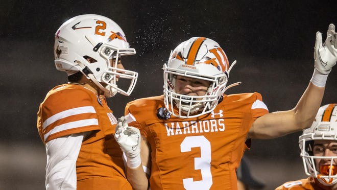 Westwood receiver Zach Pryor, right, celebrates with quarterback R.J. Martinez after catching a touchdown pass in Westwood's impressive win over Stony Point on Monday. The Warriors make their debut in the Statesman's Fab Five Class 6A poll this week.