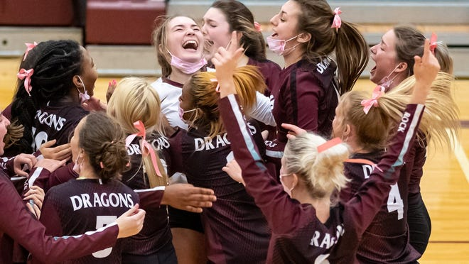 Round Rock players celebrate a win over Cedar Ridge in five sets on Tuesday at Round Rock High School. The loss was the first for Cedar Ridge in District 25-6A play.
