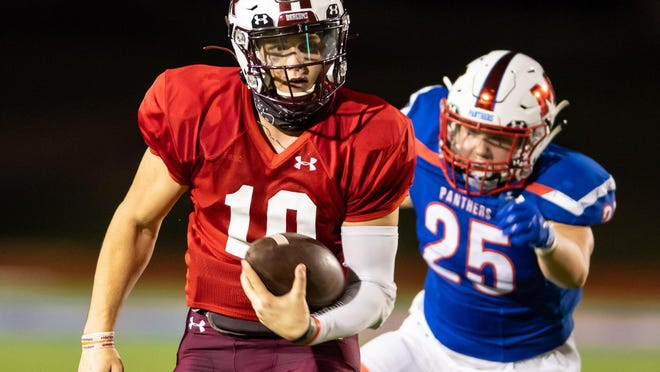 Round Rock quarterback Seth Ford, running in a game against Waco Midway in September, is committed to play at Texas-Permian Basin next season.